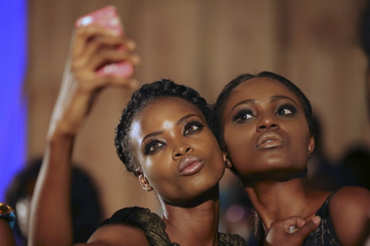 Models take a selfie backstage during Lagos fashion and design week October 29, 2014. Picture taken October 29, 2014. REUTERS/Akintunde Akinleye