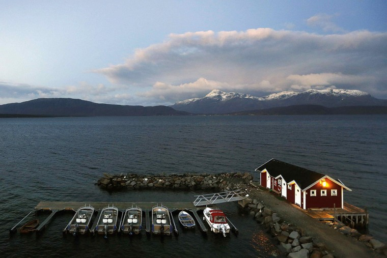General view of a small harbour and snow-capped mountains in Bals-Fiord, north of the Arctic Circle, near the village of Mestervik in northern Norway September 30, 2014. (Yannis Behrakis/Reuters)