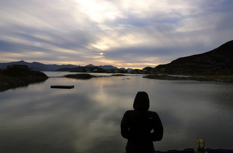 A tourist looks over on the island of Sommaroy north of the Arctic Circle, in Norway's Troms region September 30, 2014. (Yannis Behrakis/Reuters)