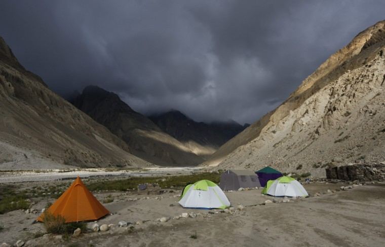 Tents stand under dark rain clouds in the valley of the river Braldu at Bardoumal near the Baltoro glacier in the Karakoram mountain range in Pakistan August 30, 2014. (Wolfgang Rattay/Reuters)