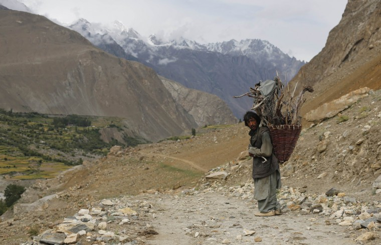 A man from the village of Askole carries firewood in the Karakoram mountain range in Pakistan August 28, 2014. (Wolfgang Rattay/Reuters)