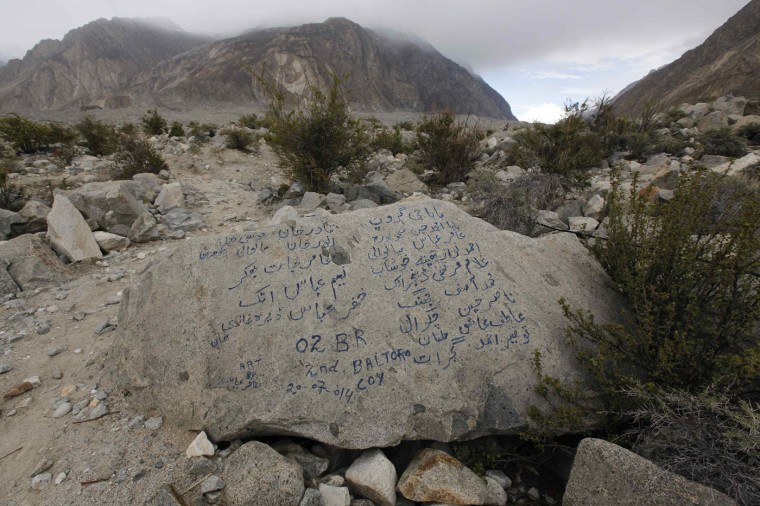 The names of the porters and members of a recent K2 trekking tour are written on a glacial stone along the K2 base camp trek near Korophong in the Karakoram mountain range in Pakistan September 11, 2014. (Wolfgang Rattay/Reuters)