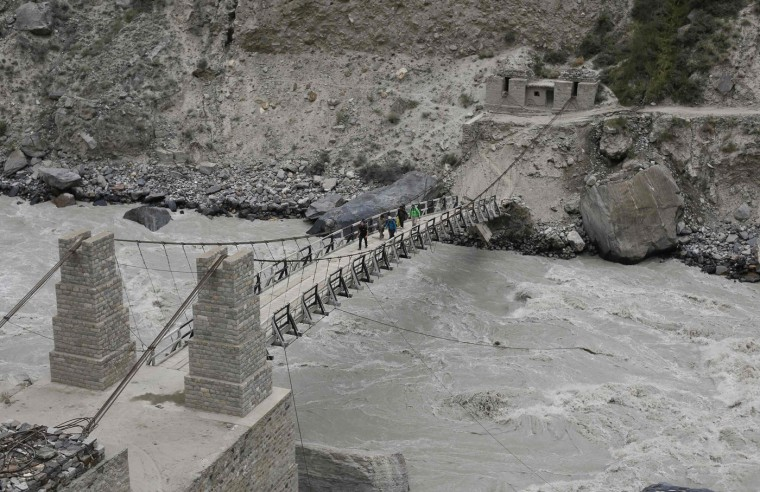 A trekking group walks over a rope bridge across the Braldu River in the Karakoram mountain range near the village of Askole in Pakistan August 27, 2014. (Wolfgang Rattay/Reuters)