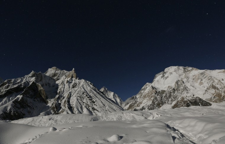 The world's second largest mountain, the 8,611 meter high K2 (seen in the distance), and the 8,051 meter high Broad Peak (R), are illuminated by the moon at Concordia, the confluence of the Baltoro and Godwin-Austen glaciers, in the Karakoram mountain range in Pakistan September 7, 2014. While other parts of Pakistan and northern India were flooded, Concordia in the Karakoram mountain range was covered with a seasonally unusual amount of snow. (Wolfgang Rattay/Reuters)