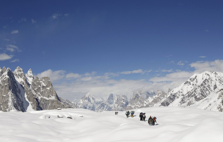 Trekkers and porters hike down the Baltoro glacier in the Karakoram mountain range in Pakistan September 7, 2014. (Wolfgang Rattay/Reuters)