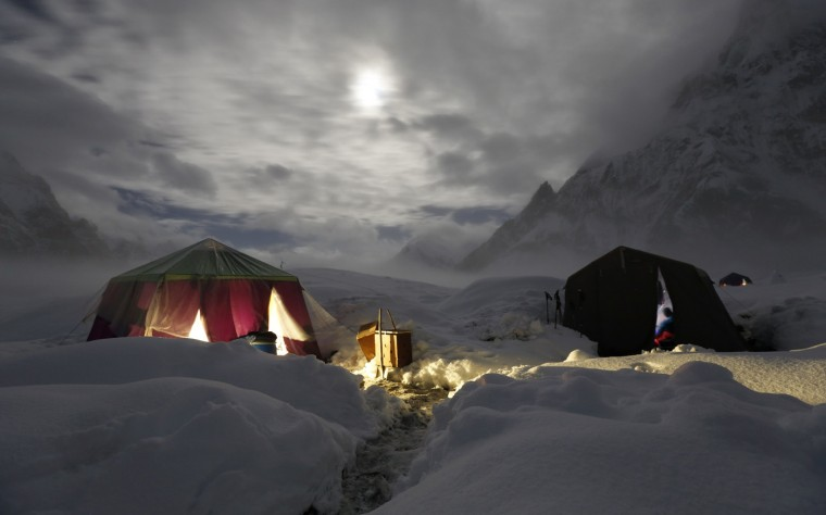 The moon illuminates the snow-covered Concordia, the confluence of the Baltoro and Godwin-Austen glaciers, near the world's second highest mountain the K2 (8,000 meters) in the Karakoram mountain range in Pakistan September 6, 2014. While other parts of Pakistan and northern India were flooded, Concordia in the Karakoram mountain range was covered with a seasonally unusual amount of snow. (Wolfgang Rattay/Reuters)