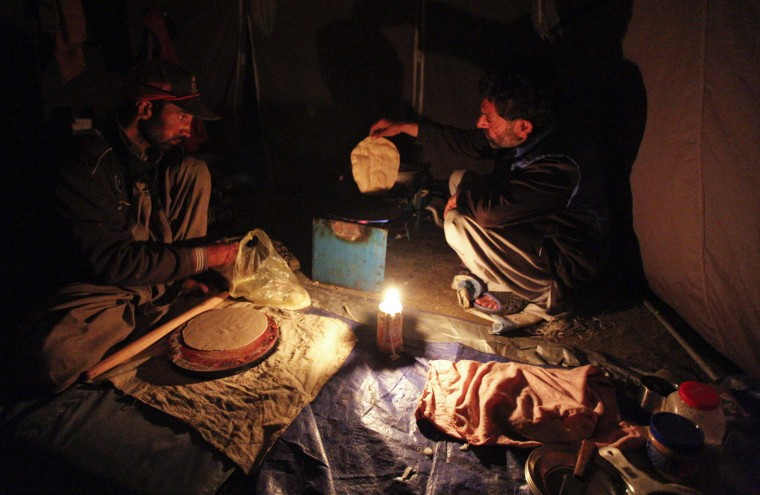 Shukrullah Baig, a 52-year-old brick layer and former cook at a five-star hotel chain cooks a chapati in the village of Askole in the Karakoram mountain range in Pakistan September 12, 2014. (Wolfgang Rattay/Reuters)