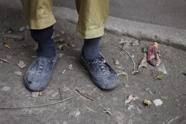 The feet of porter Ibrahim Sino, 33, are pictured following a 16-day K2 base camp trek, in the village of Askole in the Karakoram mountain range in Pakistan September 11, 2014. A local porter receives 700 Pakistani Rupee ($6.8) per day and usually carries 25kg. Owners of mules can earn three times as much, as their animals carry 75kg. (Wolfgang Rattay/Reuters)