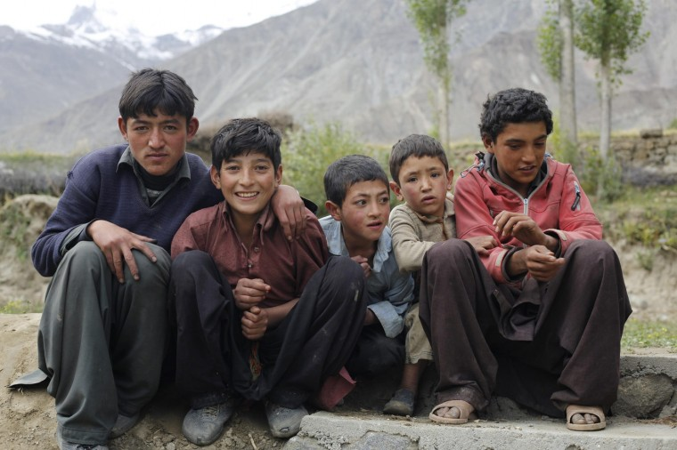 Pakistani boys pose for a picture in the remote mountain village of Askole in the Karakoram mountain range in Pakistan September 11, 2014. (Wolfgang Rattay/Reuters)