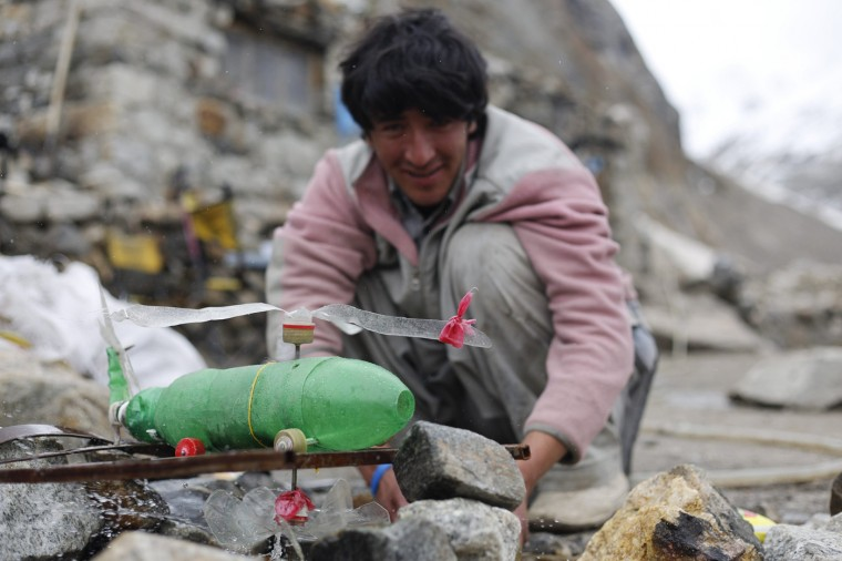 Shukrullah Baig, a 52-year-old brick layer and former cook at a five-star hotel chain cooks Vegetable Masala on his kerosene burner in the village of Askole in the Karakoram mountain range in northern Pakistan September 11, 2014. (Wolfgang Rattay/Reuters)