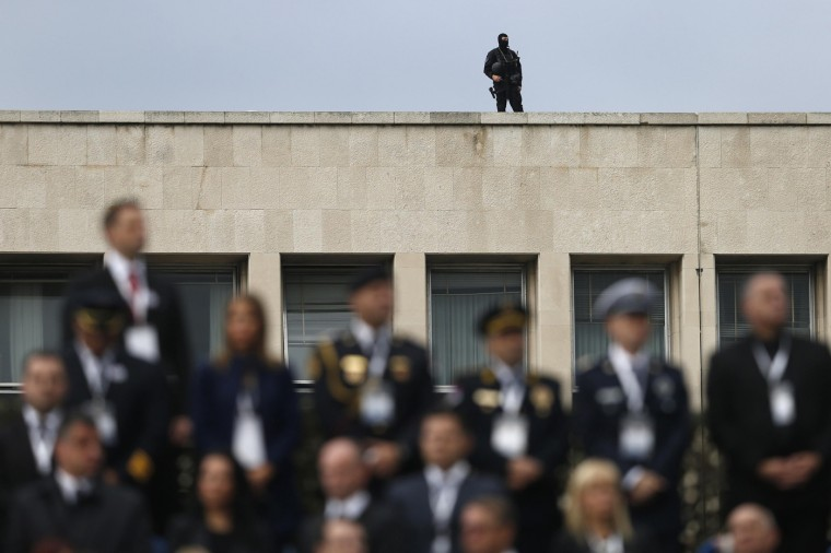 A security officer observes during a military parade to mark 70 years since the city's liberation by the Red Army in Belgrade October 16, 2014. Serbia feted Russia's Vladimir Putin with troops, tanks and fighter-jets on Thursday to mark seven decades since the Red Army liberated Belgrade, balancing its ambitions of European integration with enduring reverence for a big-power ally deeply at odds with the West. (Marko Djurica/Reuters)