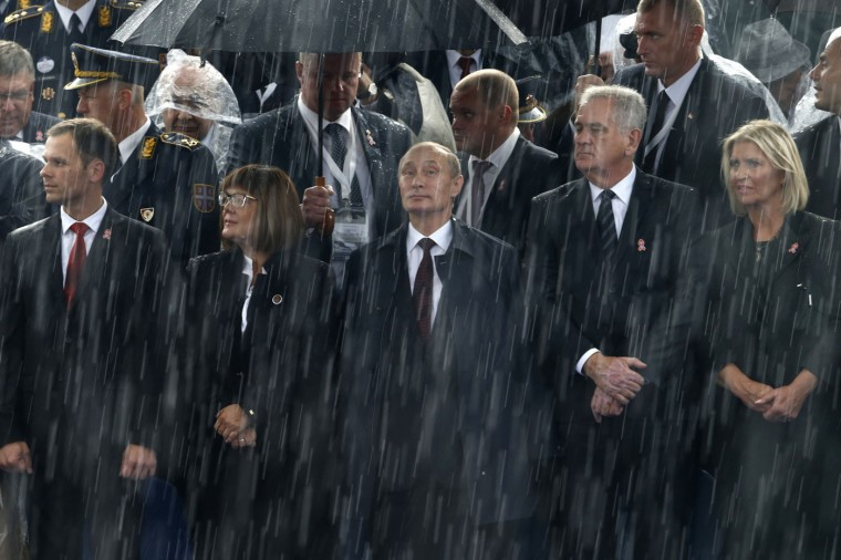 Russian President Vladimir Putin (C) and Serbian President Tomislav Nikolic (2nd R) attend a military parade to mark 70 years since the city's liberation by the Red Army in Belgrade October 16, 2014. Serbia feted Russia's Putin with troops, tanks and fighter-jets on Thursday to mark seven decades since the Red Army liberated Belgrade, balancing its ambitions of European integration with enduring reverence for a big-power ally deeply at odds with the West. (Marko Djurica/Reuters)