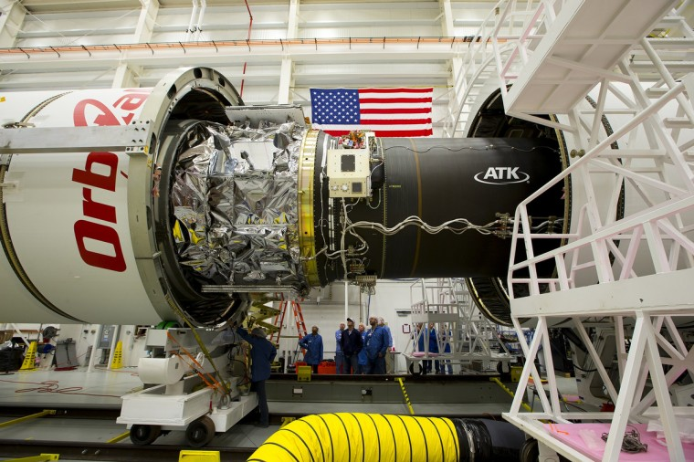 The Orb-3 mission's payload fairing (the casing around the spacecraft) is installed on Orbital Sciences Corp.'s Antares rocket on the evening of October 23, 2014, at the Horizontal Integration Facility at NASA's Wallops Flight Facility in Virginia, as seen in this handout photo from NASA. An unmanned Antares rocket exploded seconds after liftoff from a commercial launch pad in Virginia on Tuesday, marking the first accident since NASA turned to private operators to deliver cargo to the International Space Station, but officials said no one was hurt. (NASA)