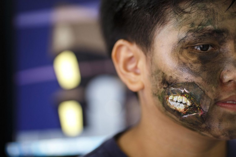 A student with his face painted attends a halloween party at a school in Bangkok October 31, 2014. (Athit Perawongmetha/AFP/Getty Images)