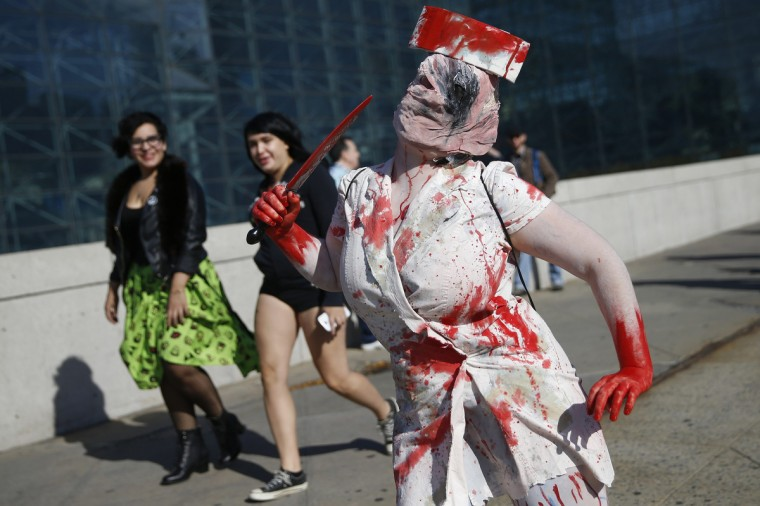 "Ashlee Mantione, dressed as the ""Dark Nurse"" from the ""Silent Hill 2"" video game, poses for a photograph at New York's Comic-Con convention October 9, 2014. The event draws thousands of costumed fans, panels of pop culture luminaries and features a sprawling floor of vendors in a space equivalent to more than three football fields at the Javits Center. Shannon Stapleton/Reuters photo"