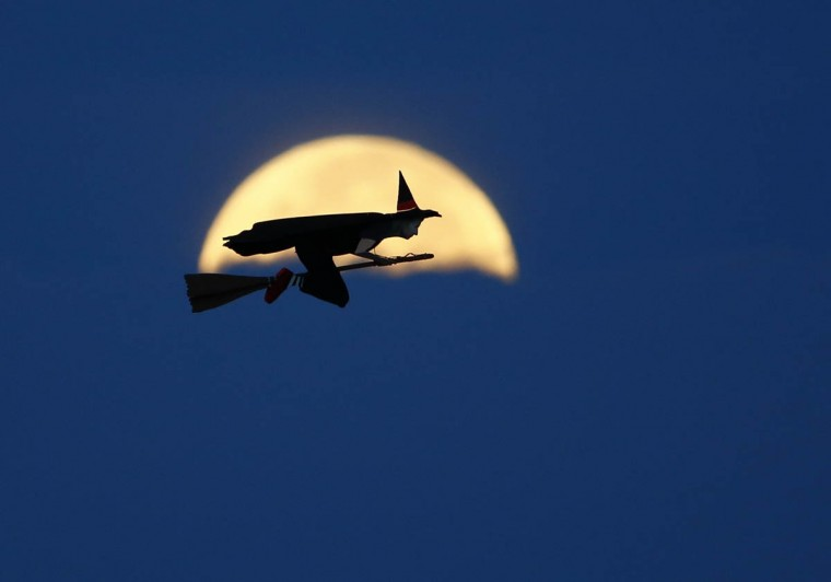 A radio-controlled flying witch makes a test flight past a moon setting into clouds along the pacific ocean in Carlsbad, California October 8, 2014. Reuters was invited to photograph the testing of the life sized device by inventor Otto Dieffenbach lll. (Mike Blake/Reuters photo)