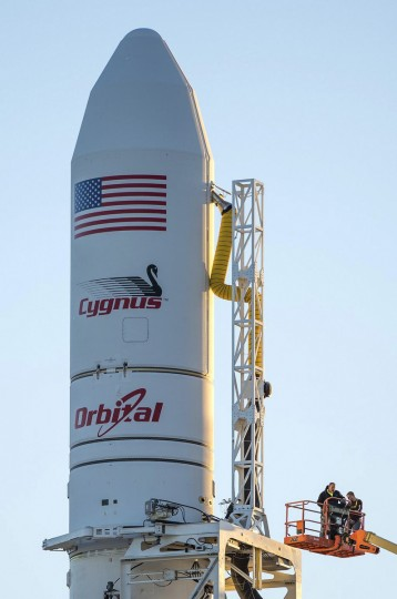 Orbital Sciences Corporation's Antares rocket and Cygnus cargo spacecraft are prepared for launch at the Mid-Atlantic Regional Spaceport on Wallops Island, Virginia in this NASA handout picture released October 27, 2014. Liftoff is scheduled for 18:45 EDT (22:45 UTC) on Monday. This will mark the fourth Cygnus mission to the International Space Station. (NASA)