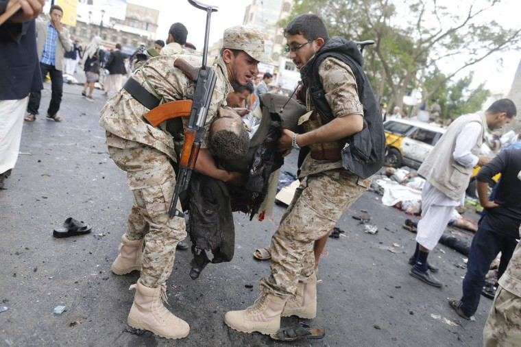 Shi'ite Houthi rebels carry a dead man at the scene of a suicide attack in Sanaa October 9, 2014. At least 20 people were killed on Thursday in the suicide attack apparently targeting a Shi'ite Muslim Houthi checkpoint in the centre of the Yemeni capital Sanaa, witnesses including a Reuters reporter said. (Khaled Abdullah/Reuters)