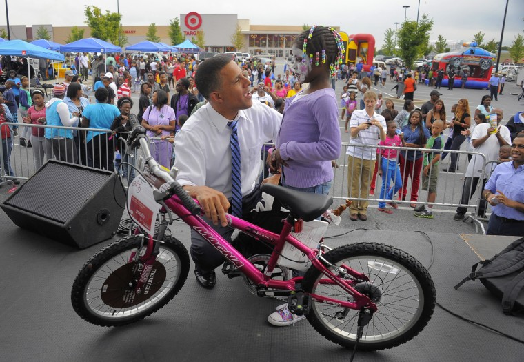 8/6/2013: Juniya Rucker, 6, meets Maryland Lt. Gov. Anthony Brown after she won a bike from a raffle called by the gubernatorial hopeful during the annual National Night Out, at the Mondawmin Mall location Tuesday, Aug. 6, 2013. (Karl Merton Ferron/Baltimore Sun )