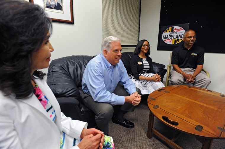 6/24/14: Republican gubernatorial candidate Larry Hogan, second left, watches election result with running mate Boyd Rutherford, right, and their respective spouse Yumi Hogan, left, and Monica Rutherford inside their campaign headquarters. (Kenneth K. Lam/Baltimore Sun)