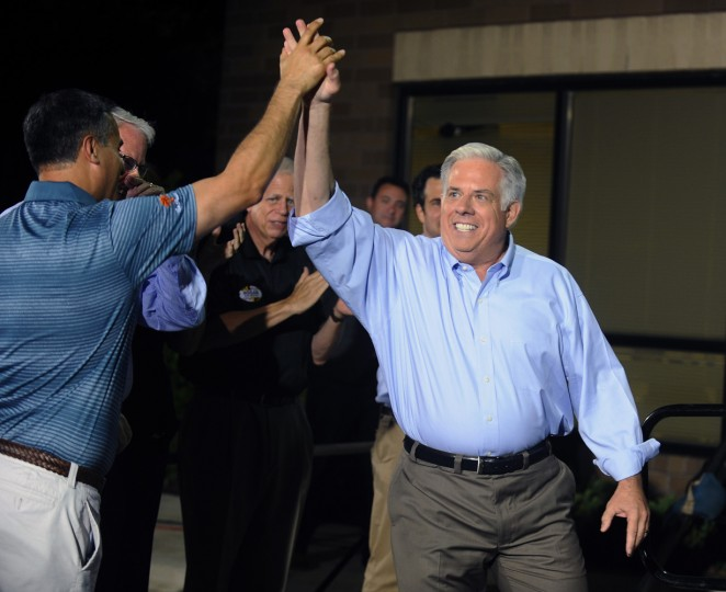6/24/14: Republican gubernatorial candidate Larry Hogan, right, highs five a supporter before he declare primary victory outside his campaign headquarter. (Kenneth K. Lam/Baltimore Sun)