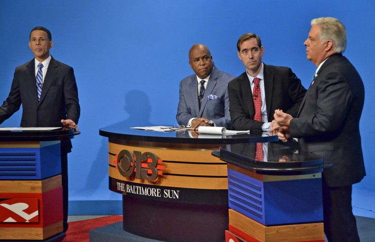 10/7/14 - Democratic candidate Lt. Gov. Anthony G. Brown and Republican candidate Larry Hogan spar during the first gubernatorial debate, moderated by WJZ anchor Vic Carter, and Baltimore Sun Editorial Page Editor Andrew A. Green. The taped debate was sponsored by WJZ-TV and The Baltimore Sun. (Amy Davis/Baltimore Sun)
