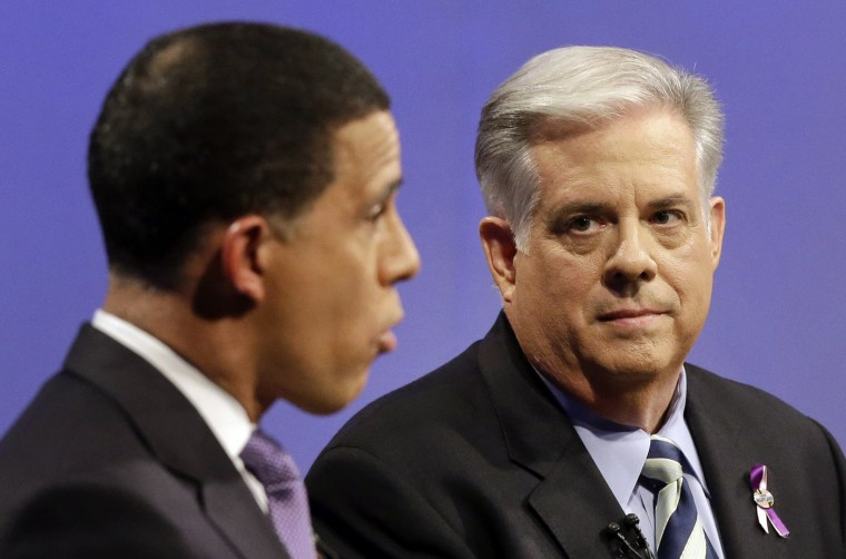 10/18/2014: Larry Hogan, right, Republican candidate for Maryland governor, listens as Democratic gubernatorial candidate, Lt. Gov. Anthony Brown, speaks during a debate at Maryland Public Television's studios in Owings Mills, Md., Saturday, Oct. 18, 2014. (AP Photo/Patrick Semansky, Pool)