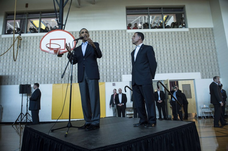 10/19/2014: Maryland Lt. Gov. Anthony Brown (R) listens while US President Barack Obama speaks to an overflow room before a campaign event at Dr. Henry A. Wise Jr. High School October 19, 2014 in Upper Marlboro, Maryland. Obama attended the event to rally for Democratic Maryland gubernatorial Anthony Brown before traveling to Chicago where he will continue to campaign and fund raise for Democrats. (Brendan Smialowski/AFP/Getty Images)