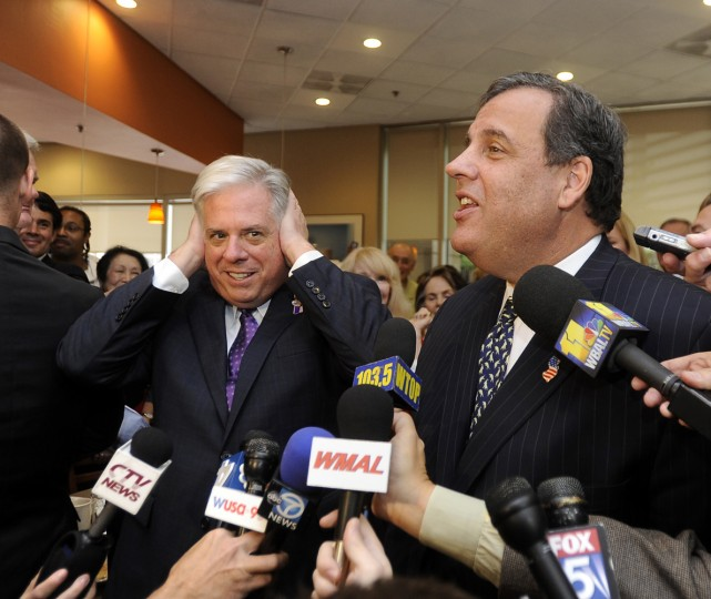 10/21/2014: Republican gubernatorial candidate Larry Hogan, left, covers his ears in response to a funny comment made by his guest, New Jersey Governor Chris Christie, right. The two campaigned together at the Original Pancake House in Bethesda. (Barbara Haddock Taylor/Baltimore Sun)