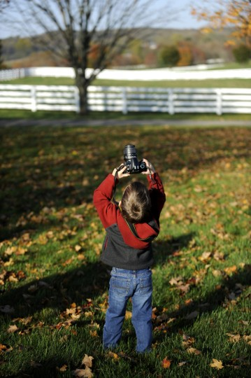 Walter Gunsiorowski, 3, tries to photograph the fall colors above him at Sagamore Farm. Cassidy Johnson/Baltimore Sun