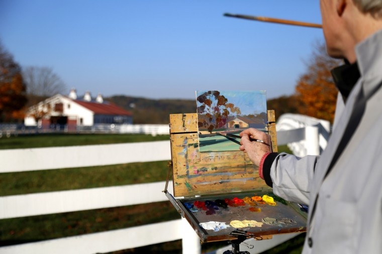 "Artist Sam Robinson paints the new stables at Sagamore Farm. Robinson was invited to paint at Sagamore anytime and is sometimes referred to as the ""resident artist."" Cassidy Johnson/Baltimore Sun"