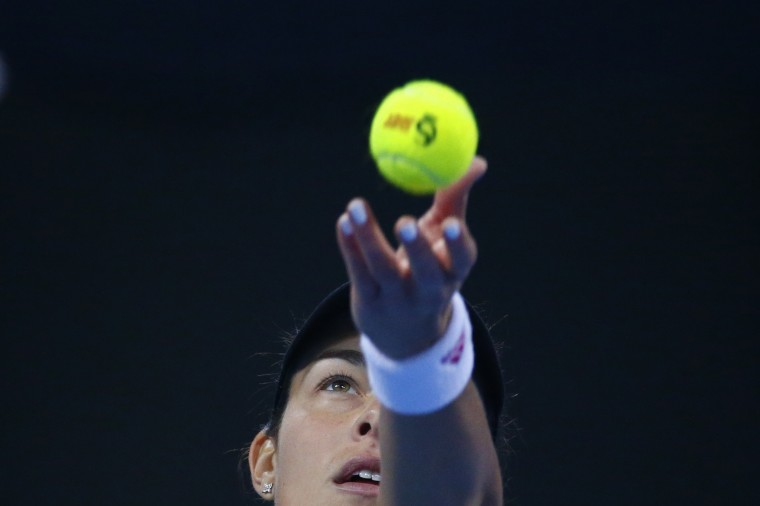 Ana Ivanovic of Serbia serves to Maria Sharapova of Russia during their women's singles semi-final match at the China Open tennis tournament in Beijing. (/Petar Kujundzic/Reuters)