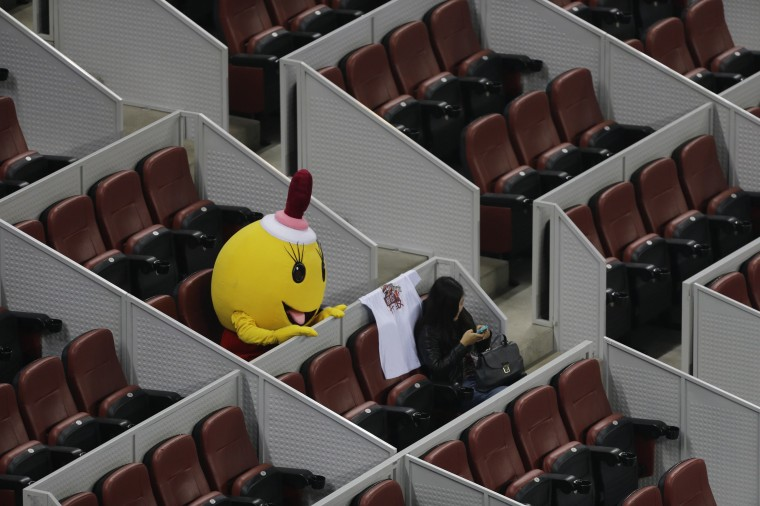 A costumed mascot waits for the men's quarter-final match between Rafael Nadal of Spain and Martin Klizan of Slovakia at the China Open tennis tournament in Beijing.. (Jason Lee/Reuters)