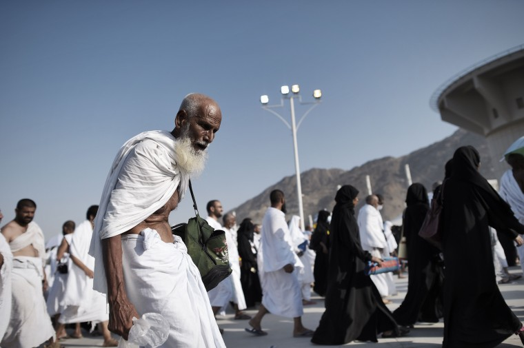 "Muslim pilgrims arrive to throw pebbles at pillars during the ""Jamarat"" ritual, the stoning of Satan, in Mina near the holy city of Mecca. Pilgrims pelt pillars symbolizing the devil with pebbles to show their defiance on the third day of the hajj as Muslims worldwide mark the Eid al-Adha or the Feast of the Sacrifice, marking the end of the hajj pilgrimage to Mecca and commemorating Abraham's willingness to sacrifice his son Ismail on God's command in the holy city of Mecca. (Mohammed Al-Shaikh/AFP-Getty Images)"