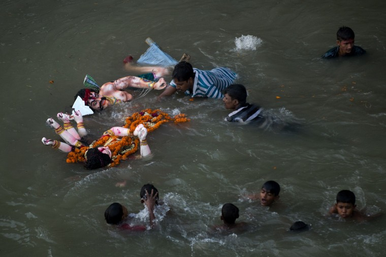 Bangladeshi Hindu devotees submerge a clay idol of the Hindu Goddess Durga during a festival in Dhaka, a ritual on the final day of the Durga Puja Festival. The four day long Durga Festival is celebrated across Bangladesh and culminates in the immersion of the idols of Hindu goddess Durga, who symbolizes power and the triumph of good over evil in Hindu mythology. (Munir uz Zaman/AFP-Getty Images)