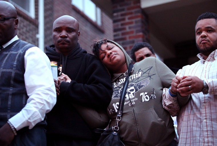 Family members attend a candlelight vigil for 18-year-old Vonderrit Myers Jr. on October 9, 2014 in St Louis, Missouri. Meyers was shot and killed yesterday by an off duty St. Louis police officer. The St. Louis area has been struggling to heal since riots erupted in suburban Ferguson, Missouri after the shooting death of 18-year-old Michael Brown by a Ferguson police officer on August 9. (Photo by Scott Olson/Getty Images)