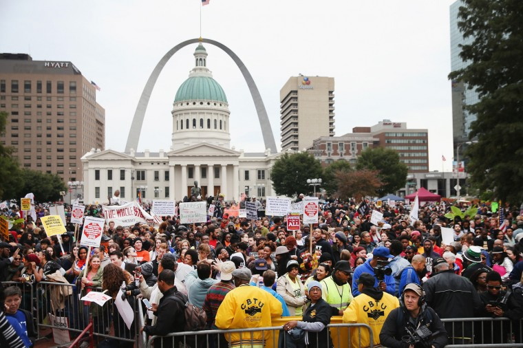 Inspired by the August 9 death of Michael Brown in Ferguson, Missouri, demonstrators march through downtown to protest racial injustice on October 11, 2014 in St. Louis, Missouri. Brown, an 18-year-old black man, was not armed when he was shot and killed by Darren Wilson, a white Ferguson police officer. (Photo by Scott Olson/Getty Images)