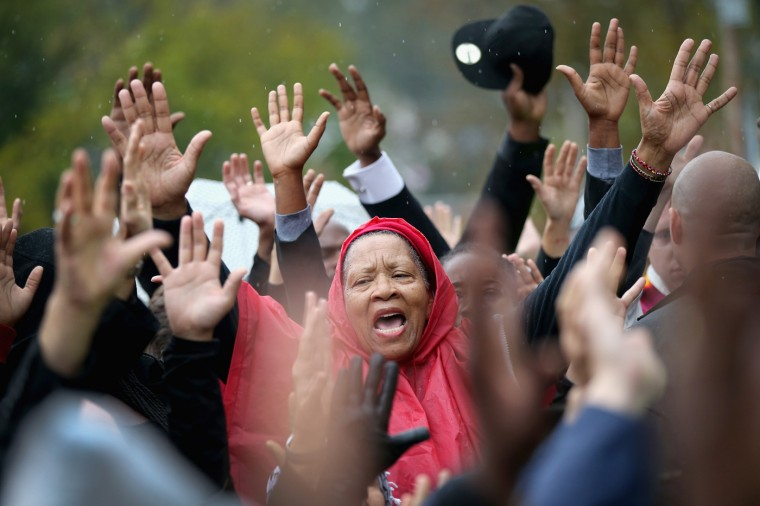 Demonstrators confront police outside the Ferguson police station on October 13, 2014 in Ferguson, Missouri. Ferguson has been struggling to heal since riots erupted following the August 9, killing of 18-year-old Michael Brown by a police officer in suburban Ferguson. Another teenager, Vonderrit Myers Jr., was killed by a St. Louis police officer on October 8. Several demonstrators and members of the clergy were arrested at the protest after a show of civil disobedience. (Photo by Scott Olson/Getty Images)