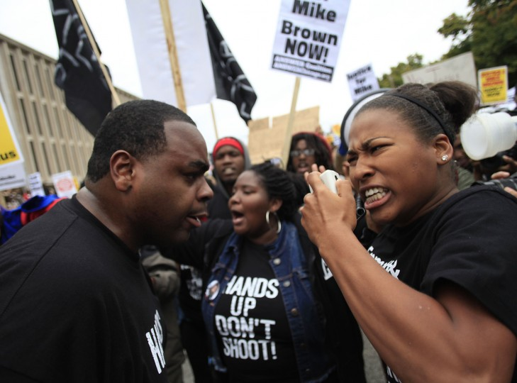 Demonstrators protest the shooting death of Michael Brown on October, 11 2014 in St. Louis, Missouri. Civil rights organizations, protest groups and people from around the country were protesting the August 9 shooting of Brown, 18, which involved Ferguson Police officer Darren Wilson in the suburban town of Ferguson near St. Louis. (Joshua Lott/AFP/Getty Images)