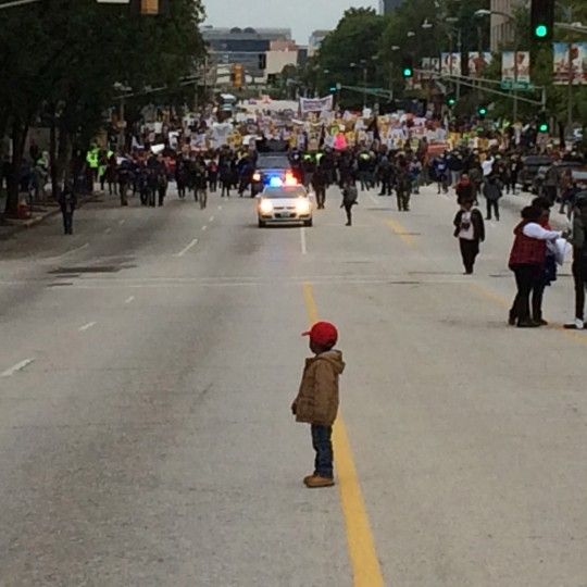 Nigel Jones-Mack, 3, waits for protesters to catch up during a Ferguson October march in downtown St. Louis on Saturday, Oct. 11, 2014. He was there with family and had been trying to encourage the marchers on with a whistle and an exaggerated marching step. He stopped after getting ahead of his grandmother, Beverly Jones, who called for him to wait. (Koran Addo/St. Louis Post-Dispatch/MCT)