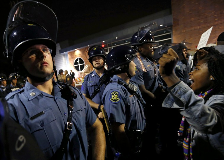 Protesters stand-off against police during a protest in Ferguson, Missouri October 10, 2014. Civil rights organizations and protest groups have invited people from around the country to join vigils and marches from Friday to Monday over the Aug. 9 shooting of Michael Brown. (Jim Young/Reuters)