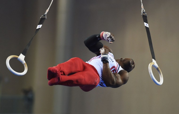 US gymnast Donnell Whittenburg performs on the ring during the men's all-around final at the Gymnastics World Championships in Nanning. (GREG BAKER/AFP/Getty Images)