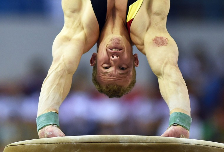 Fabian Hambuechen of Germany warms up on the vault during the men's all-around final at the Gymnastics World Championships in Nanning. (GREG BAKER/AFP/Getty Images)
