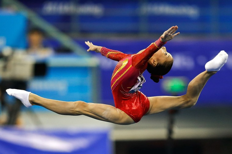 Shang Chunsong of China performs on the floor exercise during the Women's Team Final on day two of the 45th Artistic Gymnastics World Championships at Guangxi Sports Center Stadium on October 8, 2014 in Nanning, China. (Photo by Lintao Zhang/Getty Images)