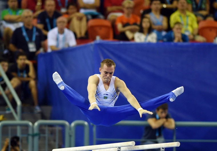 Oleg Verniaiev of Ukraine performs on the parallel bars during the men's all-around final at the Gymnastics World Championships in Nanning. (GREG BAKER/AFP/Getty Images)