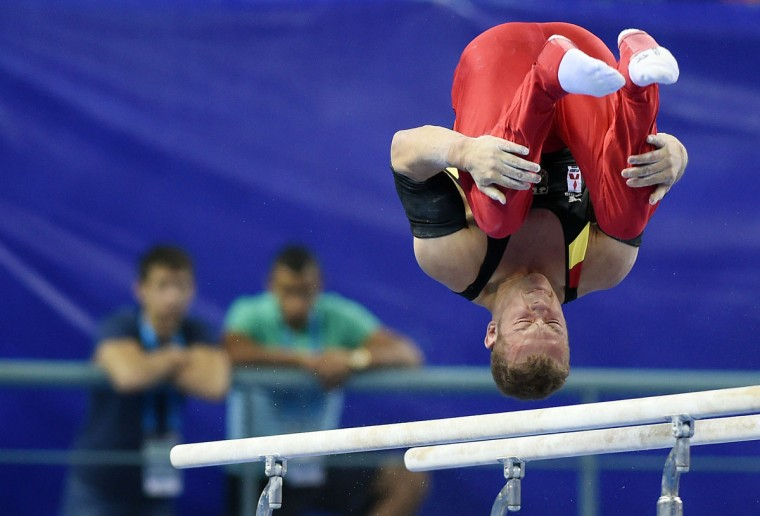 Germany's Fabian Hambuechen performs on the parallel bars during the men's all-around final at the Gymnastics World Championships in Nanning. (GREG BAKER/AFP/Getty Images)