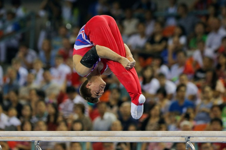 Max Whitlock of Great Britain competes on the Parallel Bars during the Men's All-Around Final in day three of the 45th Artistic Gymnastics World Championships at Guangxi Sports Center Stadium on October 9, 2014 in Nanning, China. (Photo by Lintao Zhang/Getty Images)