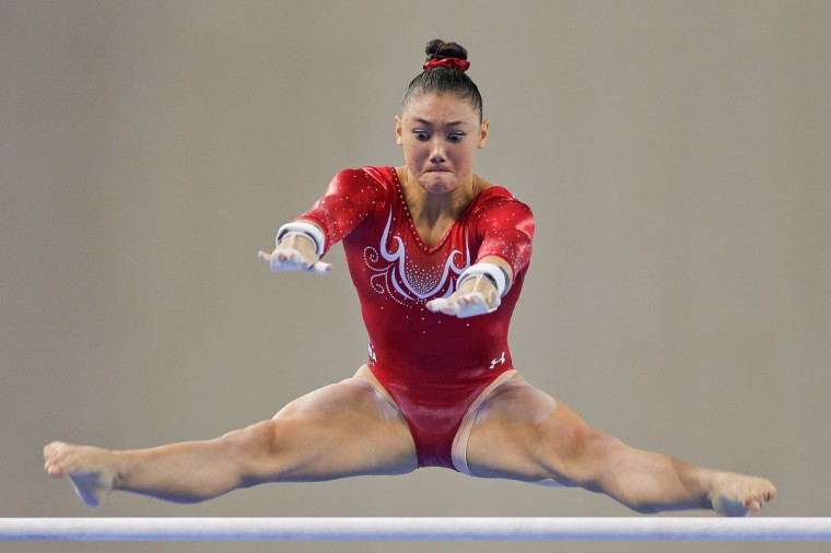 Kyla Ross of the United States performs on the uneven bars during the Women's Team Final on day two of the 45th Artistic Gymnastics World Championships at Guangxi Sports Center Stadium on October 8, 2014 in Nanning, China. (Photo by Lintao Zhang/Getty Images)