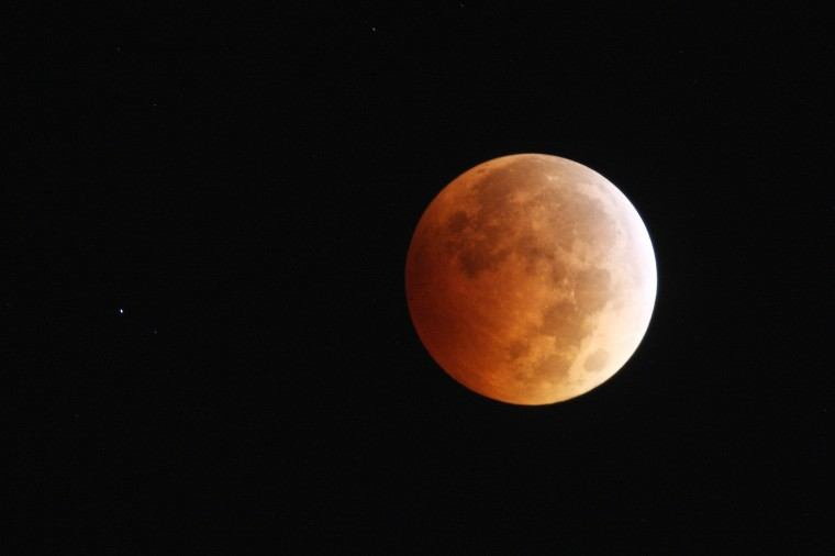 "The moon is illuminated by sunlight reflected off the Earth during a total lunar eclipse, one of four so-called ""blood moons"", on October 8, 2014 in Los Angeles, California. The first in the current tetrad of blood moons fell on Passover and the current eclipse occurs on the Jewish holiday of Sukkot, the fifth day after Yom Kippur, leading some religious people to believe that it is a prophetic sign of the end times of civilization. This blood moon appears 5.3% larger than the last one on April 15 because it occurs right after the perigee, the closest point in its orbit to the Earth. (Photo by David McNew/Getty Images)"