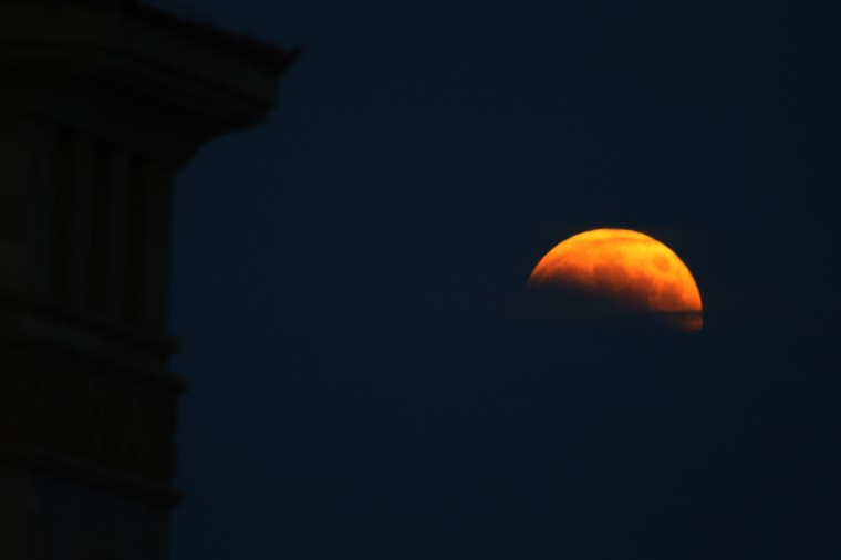 Total eclipse of the moon is seen on October 08, 2014 in Qingdao, Shandong province of China. The moon turns red and half-shadowed during total lunar eclipse in Qingdao on Wednesday. (Photo by ChinaFotoPress/ChinaFotoPress via Getty Images)